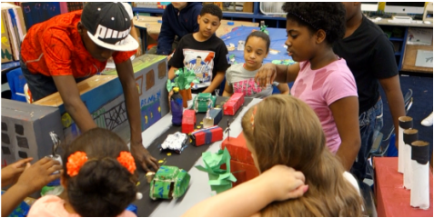 Students working on Alphabet City neighborhood model for LITTER MONSTERS video